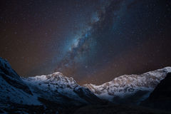 Milky way over Annapurna range,  Nepal. Double exposures of Annapurna range and Milky way as seen from Annapurna Base Camp, Nepal Royalty Free Stock Images