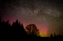 Milky Way over Aurora Ridge. The Milky Way floats of over a ridge backlit by an aurora just over the horizon Stock Photos