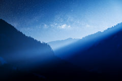 Milky way over blue mountain Royalty Free Stock Photos