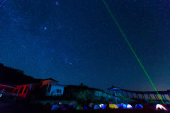 Milky Way over the camping site. With laser royalty free stock image