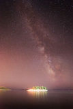 Milky way over the island Stock Photos