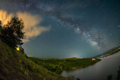 Milky way over lake Cincis in Romania Stock Photo