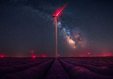Milky Way over lavender fields and wind turbine royalty free stock image