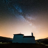 Milky way over little chapel Stock Image