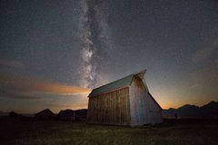 Milky Way over Mormon Row Barn. Milky Way galaxy rising over one of the barns on Mormon Row Royalty Free Stock Photography
