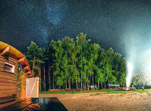 Milky Way over the mountain house and camp fire. With a lot of smoke Royalty Free Stock Photos