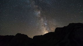 Milky way over the mountain peaks stock video