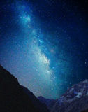 Milky Way over the mountain showing stars and gases Stock Photos