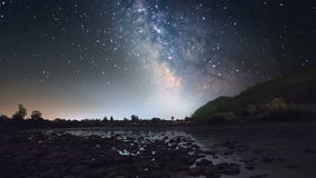 Milky Way over mountain river stock video