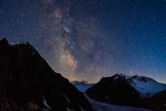 Milky Way over mountains in Alps region stock photo