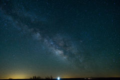 The Milky Way over a Northern Texas highway. The Milky Way can be seen in the early morning hours in Texas in the middle of spring royalty free stock photos