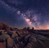 Milky Way over rocky terrain. The Milky Way rising over the rugged and rocky terrain of joshua Tree national park is an awe inspiring sight stock photo