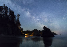 Milky Way over Ruby Beach Campfire. The Milky Way lights up the southern sky while a campfire illuminated the seas stacks on Ruby Beach in Olympic National Park Royalty Free Stock Image
