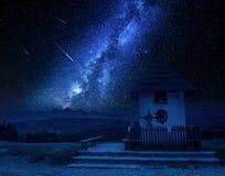Milky way over small chapel in Tatra mountains, Poland royalty free stock photos
