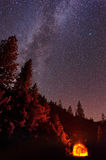 Milky Way over the Tunnel. The summer Milky Way rises over the mountain while the tunnel blazes with light in this long exposure taken at Yosemite National Park royalty free stock image
