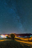 Milky Way over the village at Bran, Romania Royalty Free Stock Images
