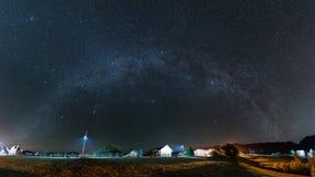 Milky Way over the village at Pestera, Romania Royalty Free Stock Photos