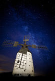Milky way over windmill Royalty Free Stock Image