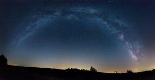 Milky Way panorama over a field Stock Photos
