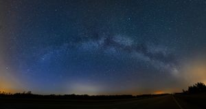 Milky Way panorama and road Royalty Free Stock Photography