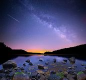 The Milky Way and Perseid Meteor. The Milky Way over Salt Fork Lake, Ohio with a Perseid meteor streaking in from the northeast Royalty Free Stock Photography