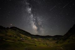 Milky way and Perseid meteor shower in the Transylvania mountains , Romania Stock Image