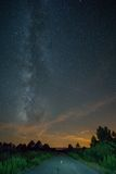 Milky Way and road at sunset Royalty Free Stock Photos