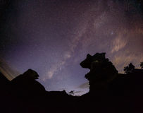 The milky way and the rock. Royalty Free Stock Images