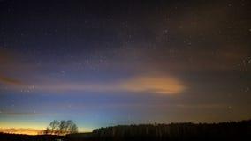Milky Way rotates around the pole star, then dawn stock footage