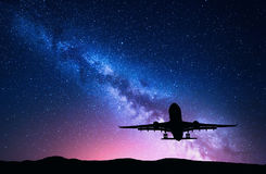 Milky Way and silhouette of a airplane Royalty Free Stock Images