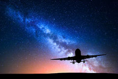 Milky Way and silhouette of a airplane Stock Photography
