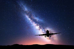 Milky Way and silhouette of a airplane Royalty Free Stock Photography