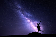Milky Way and silhouette of a girl. Night landscape Royalty Free Stock Photos