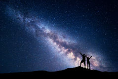 Milky Way and silhouette of happy people Stock Photography