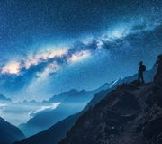 Milky Way and silhouette of standing woman on the mountain Stock Photography