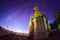 Milky Way at Standing gold Buddha image name is Wat Sra Song Pee Royalty Free Stock Photo