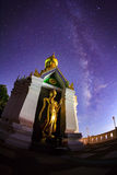 Milky Way at Standing gold Buddha image name is Wat Sra Song Pee Stock Photos