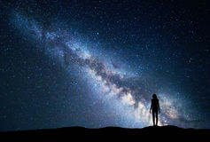 Milky Way with standing woman. Night landscape Royalty Free Stock Photography