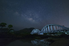 Milky Way and Starry night sky on the white Bridge landscape royalty free stock photos