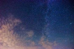 Milky Way and starry sky with clouds Stock Images