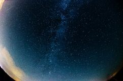 Milky Way and starry sky with clouds. Milky Way and starry sky with  clouds, fisheye image Royalty Free Stock Photography