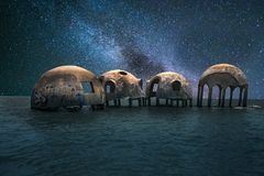 Milky way stars across a night sky over the Cape Romano dome house. Ruins in the Gulf Coast of Florida stock photos