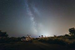Milky Way stars. Bike under stars of milky way Stock Photos