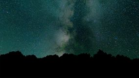 Milky way time lapse beautiful night sky. Time lapse - beautiful milky way galaxy above mountain range. Night sky and. Stars, timelapse milky way and glow above stock footage