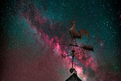 Milky Way, weather vane and stars. Night sky with stars and milky way, weather vane in front royalty free stock images