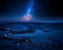 Milky way and winding road with cypresses, Tuscany. Europe stock photography
