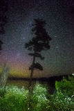 Milkyway and aurora. Milky way and northern light show in the night sky at the same time Stock Photo