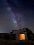 Milkyway and an old house Stock Images