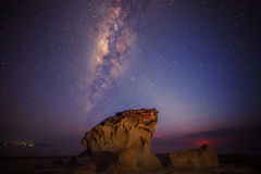 Milkyway rise above a standing stone stock photos