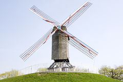 Mill. Isolated mill in a mountain in brugges belgium Stock Photos